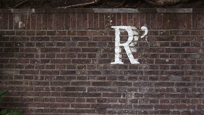 R written on a wall
