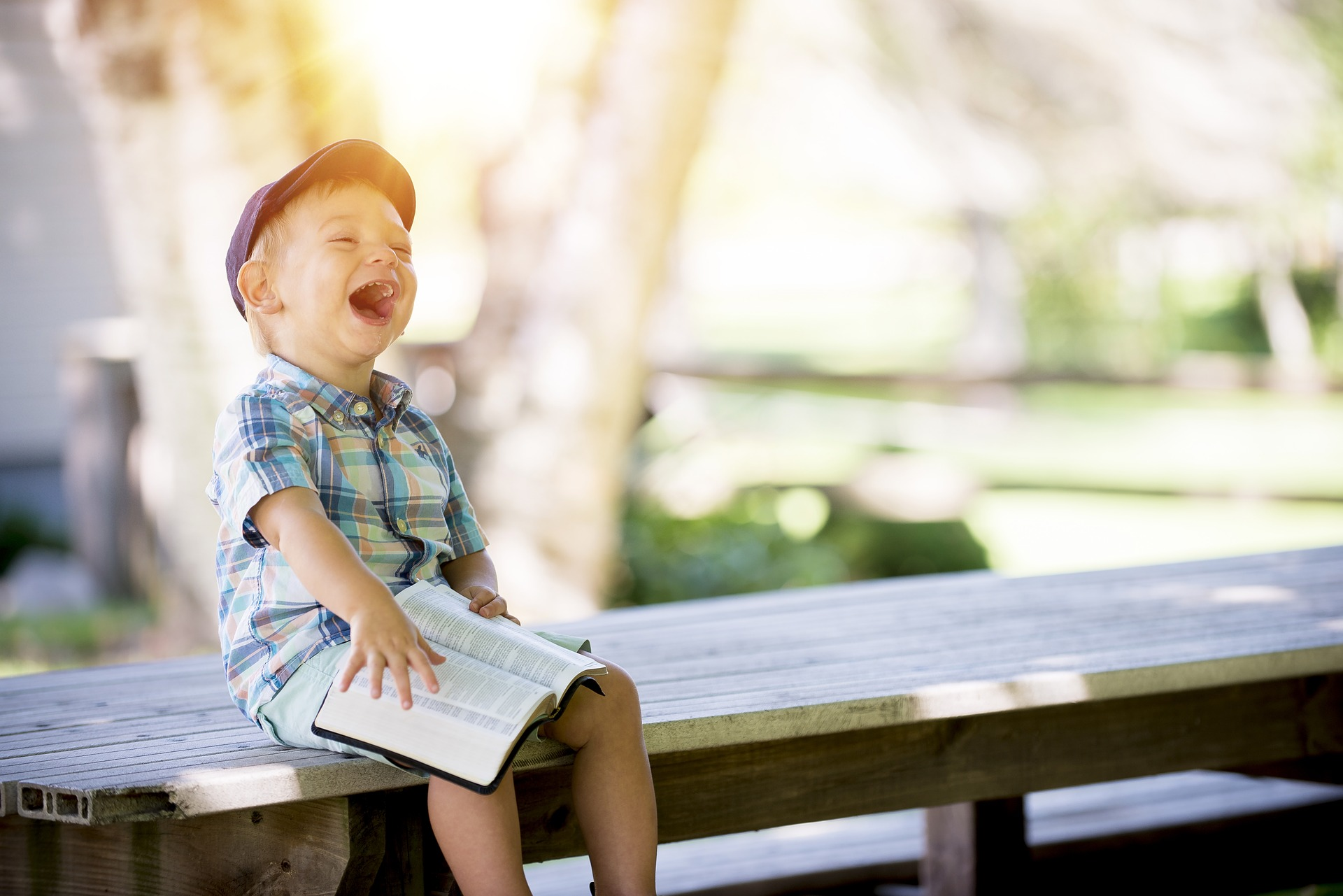 laughing child with book website images